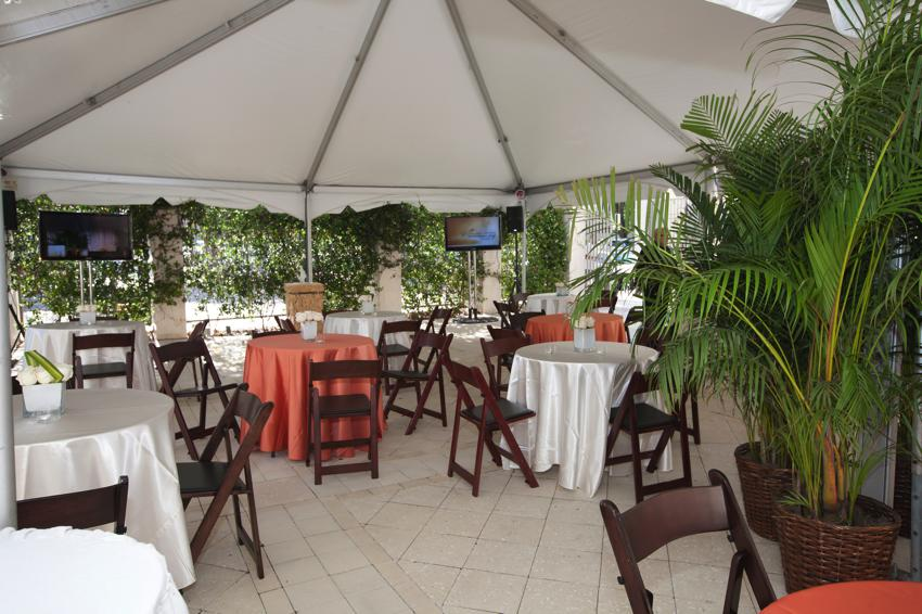 ARELLANO CONSTRUCTION COURTYARD WITH TENT AND TABLES