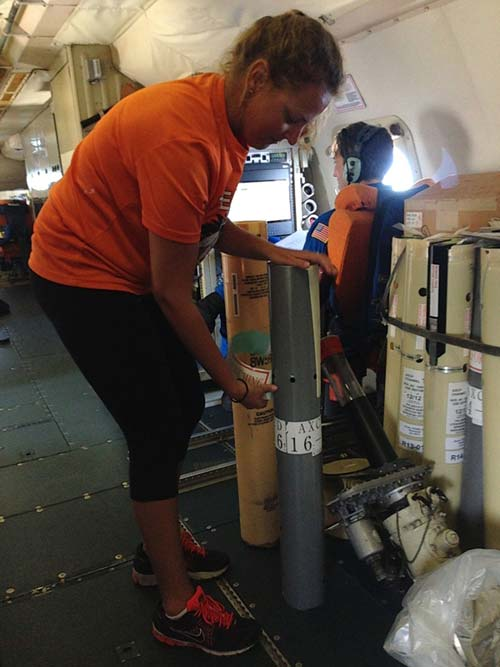 Rosenstiel Ph.D. student Johna Rudzin prepares to drop one of the 55 aircraft ocean instruments into the sea to study hurricane intensity in the Caribbean.