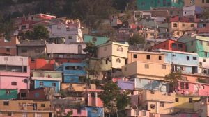 Vibrantly painted homes dot a hillside outside Port-au-Prince, Haiti
