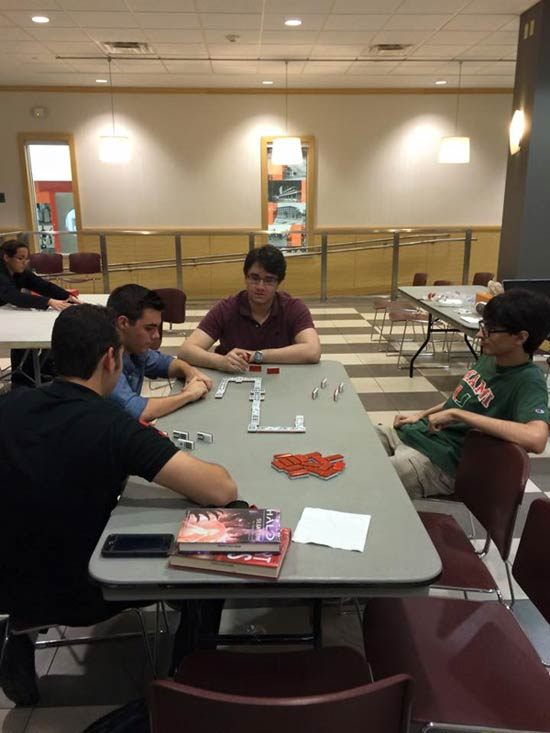 Members of the Association of Cuban-American Engineers (ACE) at UM often get together to play dominoes in the Engineering building.